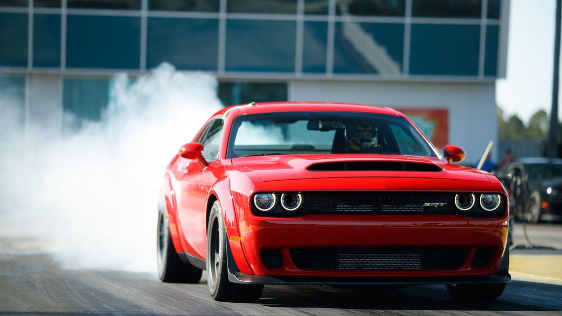 Challenger Srt8 bold, expressive styling, its large size, its luxurious interior